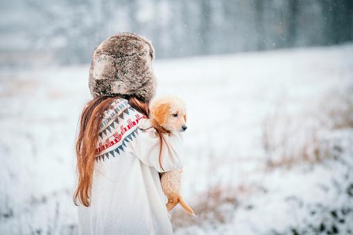 Caucasian Ethnicity「Woman And Golden Retriever Puppy Enjoying Snowy Day」:スマホ壁紙(6)