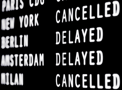 Waiting「Cancelled and delayed flights on a airport screen」:スマホ壁紙(3)