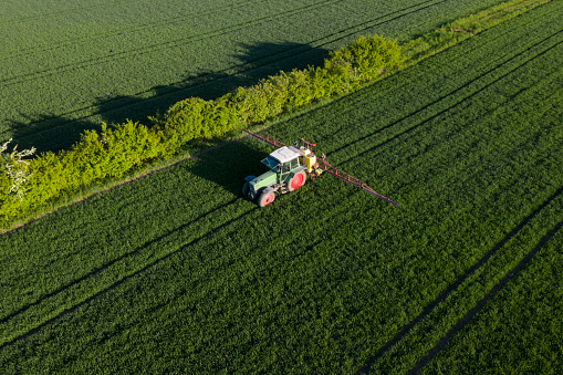 Insecticide「Tractor working in field of wheat, aerial view」:スマホ壁紙(18)