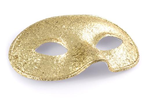 ラメグリッター「ゴールドのグリッター輝くフェイスマスクの白い背景に」:スマホ壁紙(10)