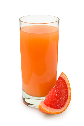 Drinking「Glass of fresh squeezed grapefruit juice next to a wedge」:スマホ壁紙(7)