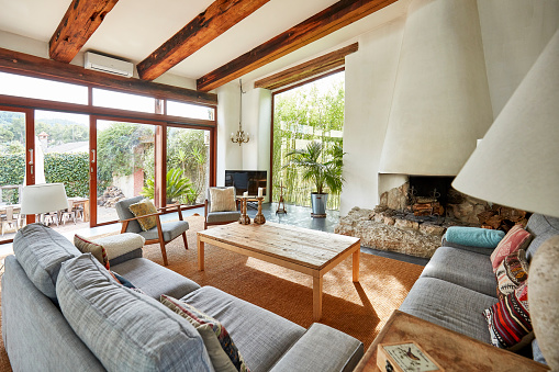 Spanish Culture「Cozy fireplace in a Mediterranean farmhouse living room」:スマホ壁紙(2)