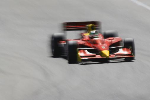 Motor Racing Track「Formula race car racing on track (blurred motion)」:スマホ壁紙(7)