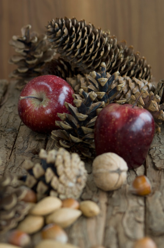 Walnut「Apples, nuts and pine cones for christmas on table」:スマホ壁紙(19)