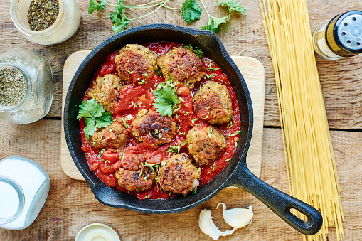 Meat Dish「Vegan meatless balls in tomato sauce in a cast iron pan」:スマホ壁紙(8)