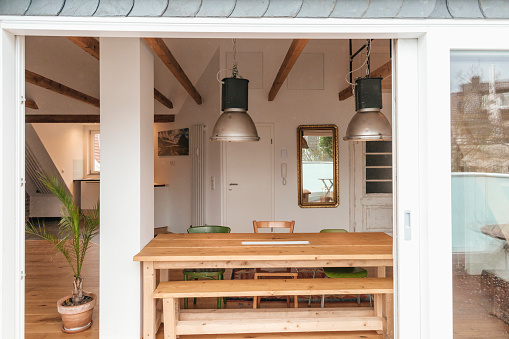Dining Table「Dining area in a loft seen from terrace」:スマホ壁紙(12)