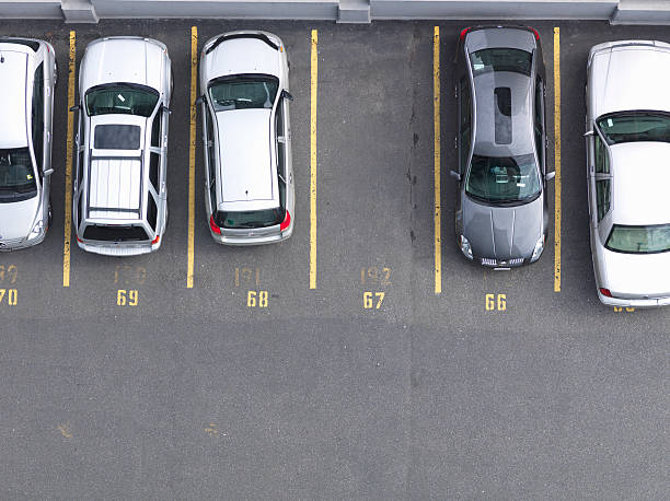 Overhead view of cars in parking lot, one empty :スマホ壁紙(壁紙.com)