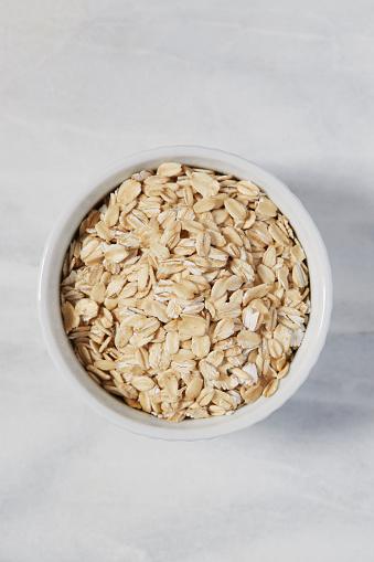 Oats - Food「Overhead view of oats in bowl」:スマホ壁紙(0)