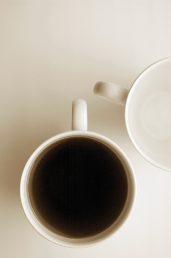 Two Objects「Overhead view of one empty white coffee cup and one with black coffee」:スマホ壁紙(19)