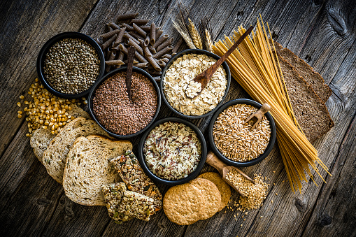 Brown Rice「Large group of wholegrain food shot on rustic wooden table」:スマホ壁紙(16)