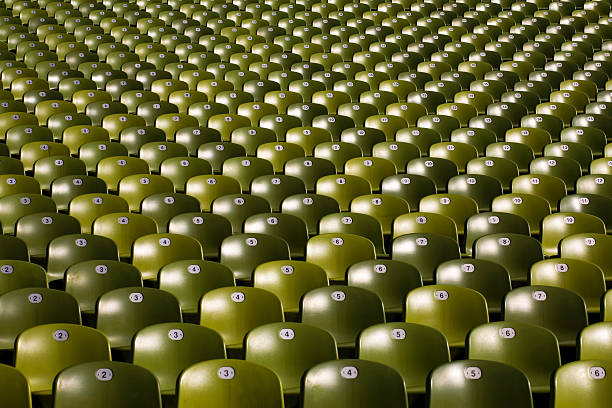 large group of green plastic seats in symetric rows:スマホ壁紙(壁紙.com)