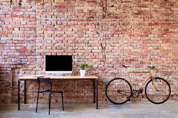 Workspace and bicycle at brick wall in office:スマホ壁紙(壁紙.com)