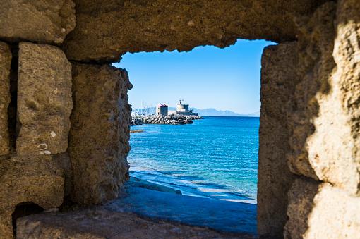 Aegean Sea「Greece, Rhodes, View through a window at the coast to the okld town」:スマホ壁紙(9)