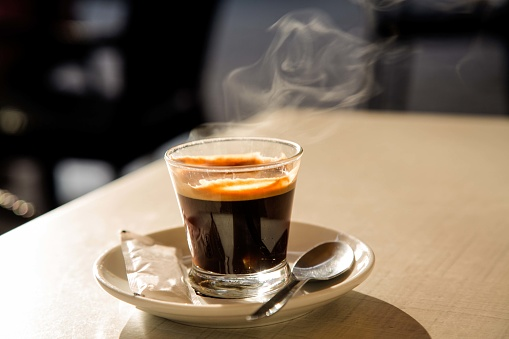 Focus On Foreground「Steaming espresso coffee on cafe table」:スマホ壁紙(2)