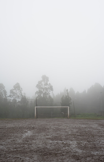 雨「Spain, Galicia, Valdovino, muddy soccer field on a rainy and foggy day」:スマホ壁紙(15)