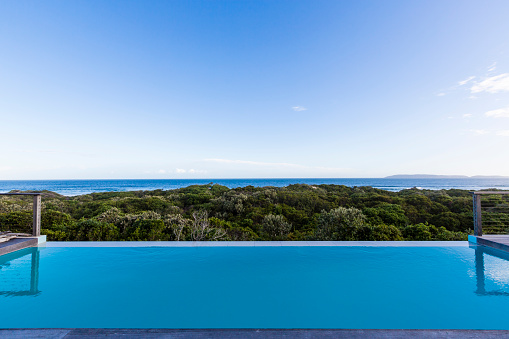 Infinity Pool「Luxury villa pool deck overlooking forest and ocean」:スマホ壁紙(6)