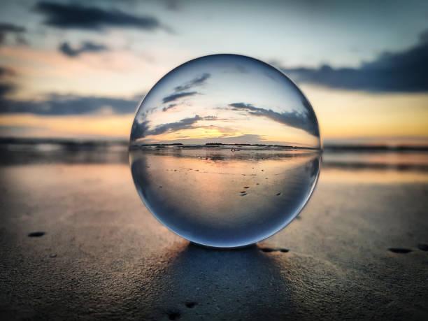 Watching sunrise throught a lens ball - Riviera Romagnola:スマホ壁紙(壁紙.com)