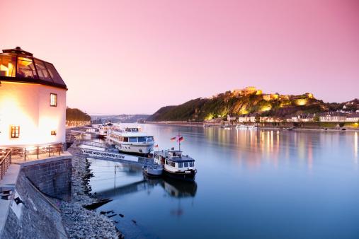 Rhineland-Palatinate「Koblenz, View of cruise ships and fortress Ehrenbreitstein with restaurant in foreground」:スマホ壁紙(19)