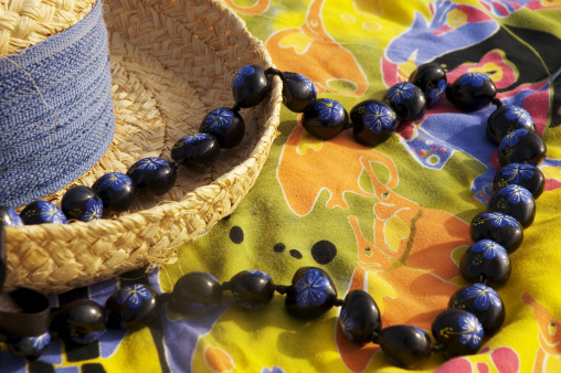 Floral Garland「Straw hat with blue band on Colorful pareo (sarong) with hand painted kukui nut lei.」:スマホ壁紙(6)