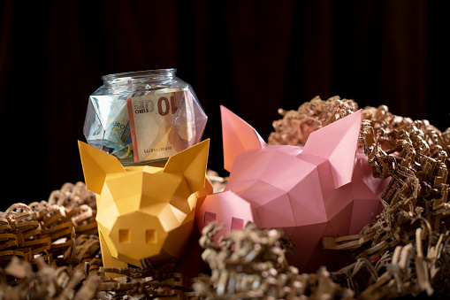 Teenager「Low poly paper piggy banks in a nest of cardboard 'straw', with a low poly glass jar with money」:スマホ壁紙(14)