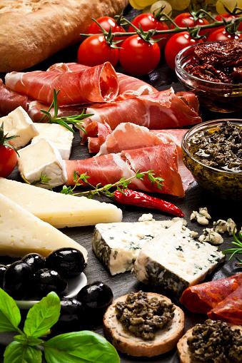 Buffet「Delicious appetizers on dark slate table」:スマホ壁紙(3)