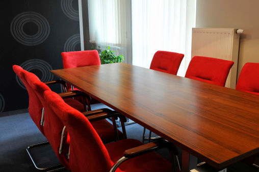 Corporate Business「Small office interior with wooden desk, red comfortable armchairs, window」:スマホ壁紙(15)