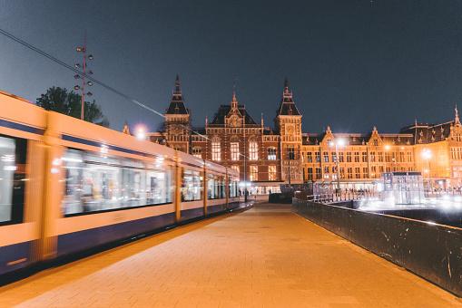 Amsterdam「Tram in motion near the railway station in Amsterdam」:スマホ壁紙(11)