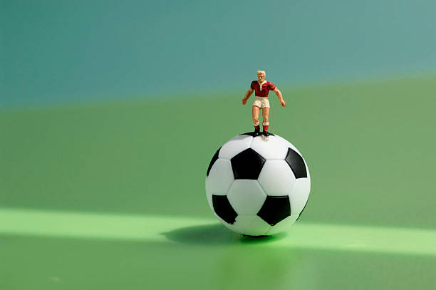 Toy figurine on football:スマホ壁紙(壁紙.com)
