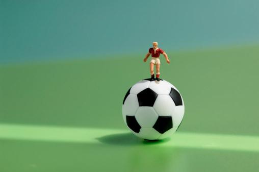 Figurine「Toy figurine on football」:スマホ壁紙(15)