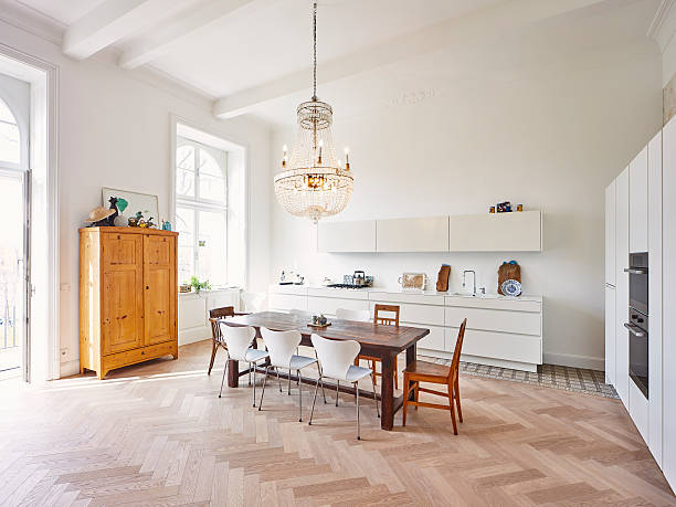 Modern kitchen with dining table in a refurbished old building:スマホ壁紙(壁紙.com)