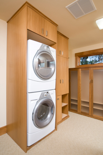 Washing「Washer and dryer stacked on each other in a cabinet」:スマホ壁紙(13)