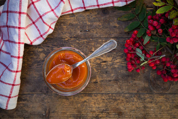 Rowanberries, kitchen towel and glass of rowanberry jam on dark wood:スマホ壁紙(壁紙.com)