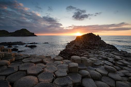 Basalt「United Kingdom, Northern Ireland, County Antrim, View of causeway coast, Giant's Causeway at sunset」:スマホ壁紙(2)
