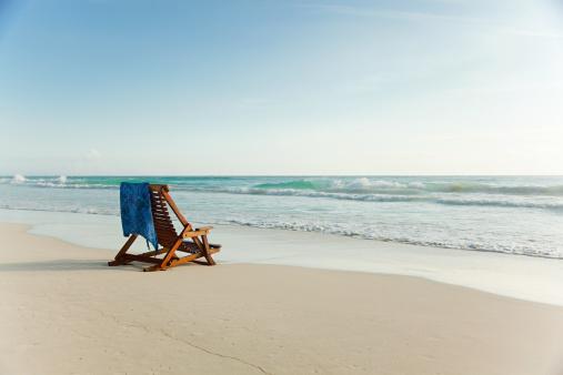 Beach「Deck chair on sandy beach at water's edge」:スマホ壁紙(9)