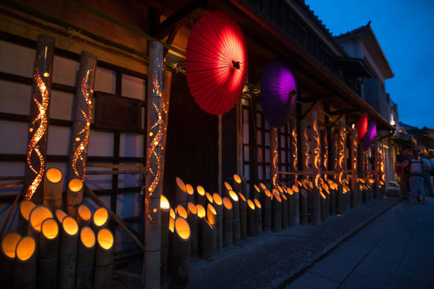 Bamboo and paper umbrella candle lights in Obon night event  in Japan:スマホ壁紙(壁紙.com)