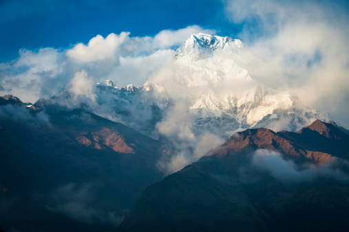 Annapurna Conservation Area「Himalayas clouds swirling around Annapurna snowy peaks Nepal」:スマホ壁紙(8)
