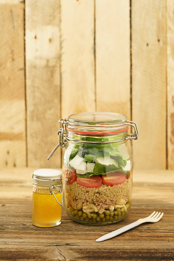 Vinaigrette Dressing「Preserving jar of mixed salad with peas, tuna, couscous, tomatoes, tuna, feta and jar of vinaigrette dressing」:スマホ壁紙(19)