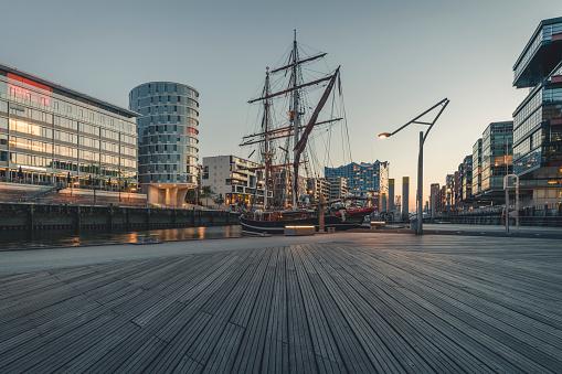 Moored「Ship at harbor against sky in HafenCity during sunset, Hamburg, Germany」:スマホ壁紙(15)
