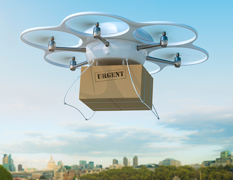 Land Vehicle「Delivery drone carrying urgent shipment box in a city.」:スマホ壁紙(5)