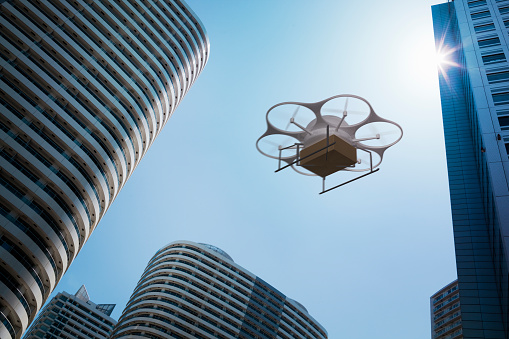 City Life「Delivery drone flying above high rise apartments」:スマホ壁紙(4)