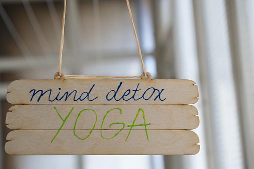Sign「Mind Detox Yoga sign hanging from ceiling」:スマホ壁紙(18)