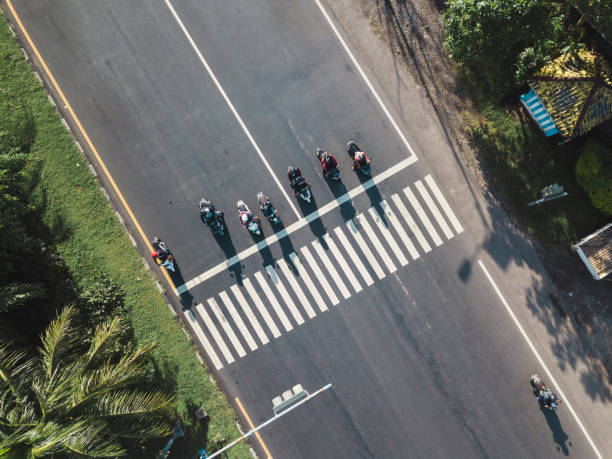 Indonesia, Bali, Sanur, Aerial view of motorbikes waiting at zebra crossing on the road:スマホ壁紙(壁紙.com)