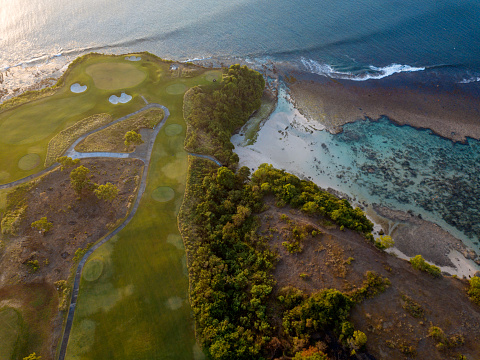 Sand Trap「Indonesia, Bali, Aerial view of golf course with bunker and green at coast」:スマホ壁紙(12)