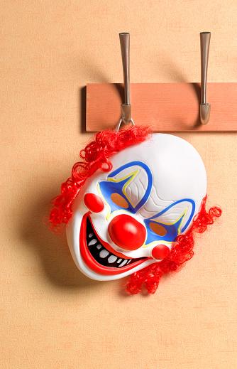 Evil「Clown Mask hanging on hallway coat hook」:スマホ壁紙(6)