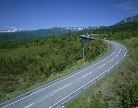 Japan「Winding road through scenic forest and mountains, Biei, Hokkaido, Japan」:スマホ壁紙(7)