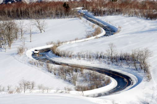 Nikko City「Winding road through a snow covered landscape, Kirifuri Kogen, Nikko, Tochigi Prefecture, Japan」:スマホ壁紙(8)