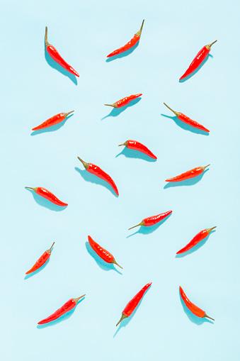 Vegetables「Red chilli peppers on blue background」:スマホ壁紙(3)
