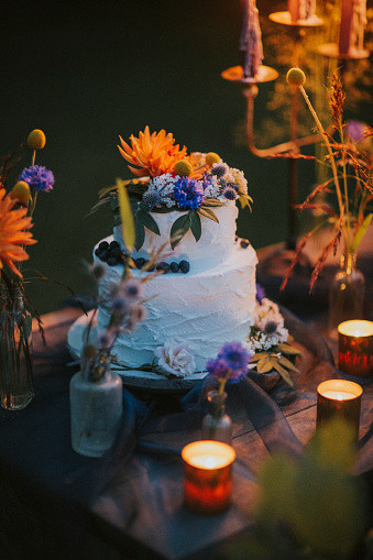 Rebellion「Wedding cake on table with candles outdoors」:スマホ壁紙(3)