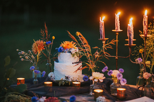 Wedding Cake「Wedding cake on table with candles outdoors」:スマホ壁紙(12)