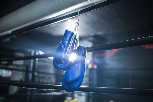 Fighter「Boxing gloves hanging in boxing ring」:スマホ壁紙(5)